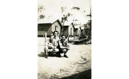 Elsie Solly and friends Ivy and the YMCA representative outside four of the huts where the AWAS was barracked, c 1942. Courtesy Elsie Solly