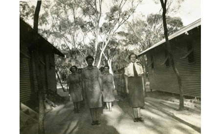 Elsie Solly and comrades standing between barracks on morning parade before starting work at 8am. Courtesy Elsie Solly