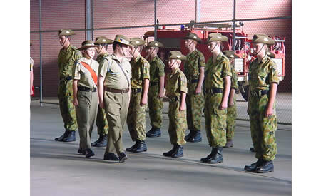 The SJACU 2005 end of year Graduation Parade occurring inside Building J1. The inspection being conducted by the unit's Officer Commanding CAPT (AAC) Mark Gargano and being escorted by Cadet Warrant Officer Class 2 Morag McGregor. Cadets visible (left to right) are CDTLCPL Dion Syson, CDT Thomas Bennetts, CDT Jonathan Dohnt, CDT Gary Bottacin, CDT Jack Mainard, CDTLCPL Andrew Lee, CDT Rebekah Mackie and CDT Imogene Fox. Courtesy Mark Gargano, (Formerly) Captain (AAC), Officer Commanding St Joseph's Army Cadet Unit, Northam.
