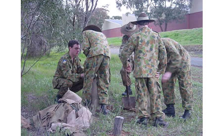 Cadet Sergeant Justin Fox teaching sand-bagging techniques as a part of emergency management training in the bush on the south side of Building J1.  Courtesy Mark Gargano, (Formerly) Captain (AAC), Officer Commanding St Joseph's Army Cadet Unit, Northam.