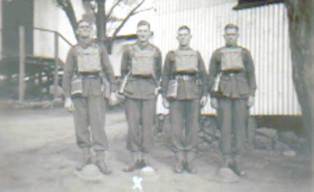 Ray Reynolds, Ted Brindle, Tom Doherty and Snooks Adams in their drill packs, Northam Camp, 1941. Tom Doherty and Snooks Adams were killed in action. Courtesy Ted Brindle