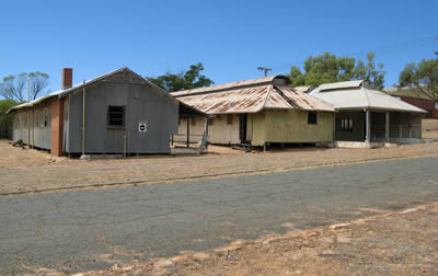 View of a group of corrugated-iron buildings at Northam Army Camp.